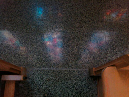 "Reflected image of chapel windows - ""a seeing within seeing."""